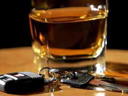 car keys sitting next to a glass of whiskey